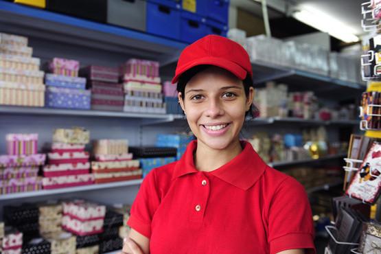 Salesgirl working in gift box store